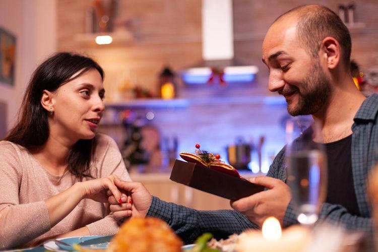 Happy friends sitting in restaurant