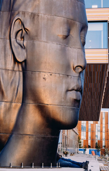 Close-up of statue against building in city