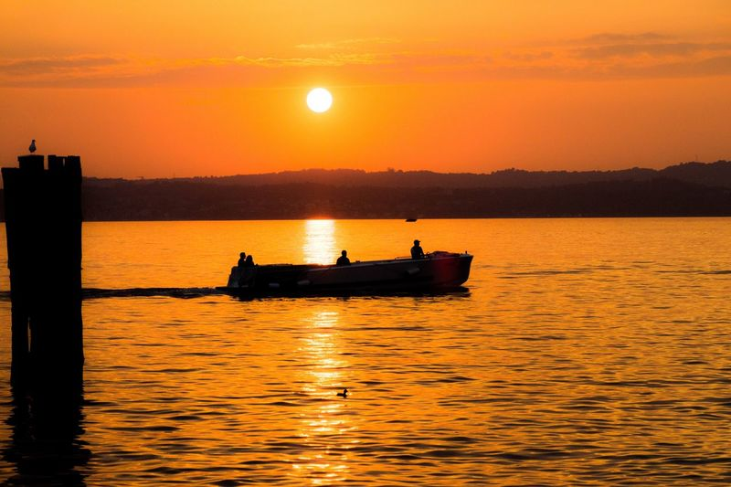 Sunset Sky Water Nautical Vessel Orange Color Transportation Waterfront Scenics - Nature Beauty In Nature Silhouette Mode Of Transportation Tranquility Reflection Idyllic Outdoors Sun Tranquil Scene