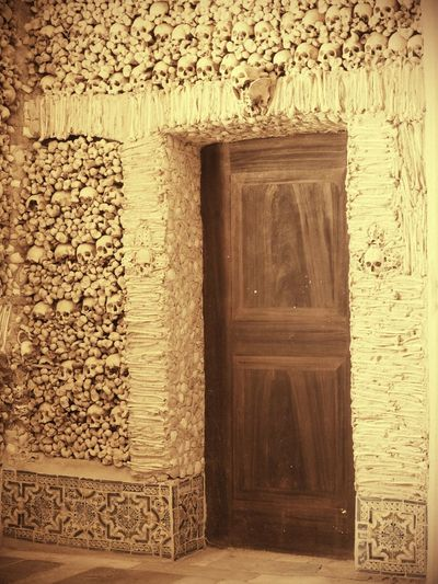 Door to death Door Bone  Skull Human Body Part Capela Dos Ossos Évora  Ancient History Architecture Close-up Built Structure Building Exterior Textured  Detail