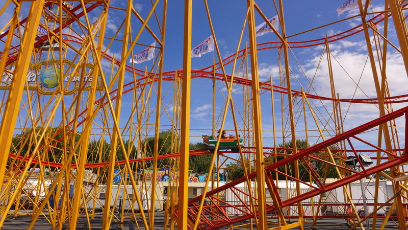 Hamburger Dom Achterbahn Colour Of Life Blue Cloud - Sky Coloured Colours Day Engineering Fun Funfair Happiness High Speed Kermis Kirmes Low Angle View Metallic Looping Outdoors Red Roller Coaster Steel Tourism Yellow Hidden Gems  Fresh On Eyeem
