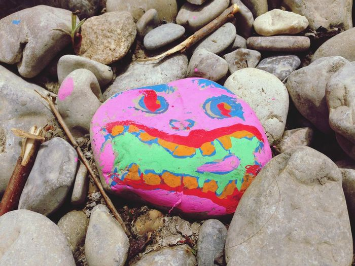 Smiley face painted on a pebble. River Eygues, Nyons, France. Pebble Pebbles Pebble Painting Face Smiley Face Smiling Face Childlike Childish Painted France French Rock Rocks Art ArtWork