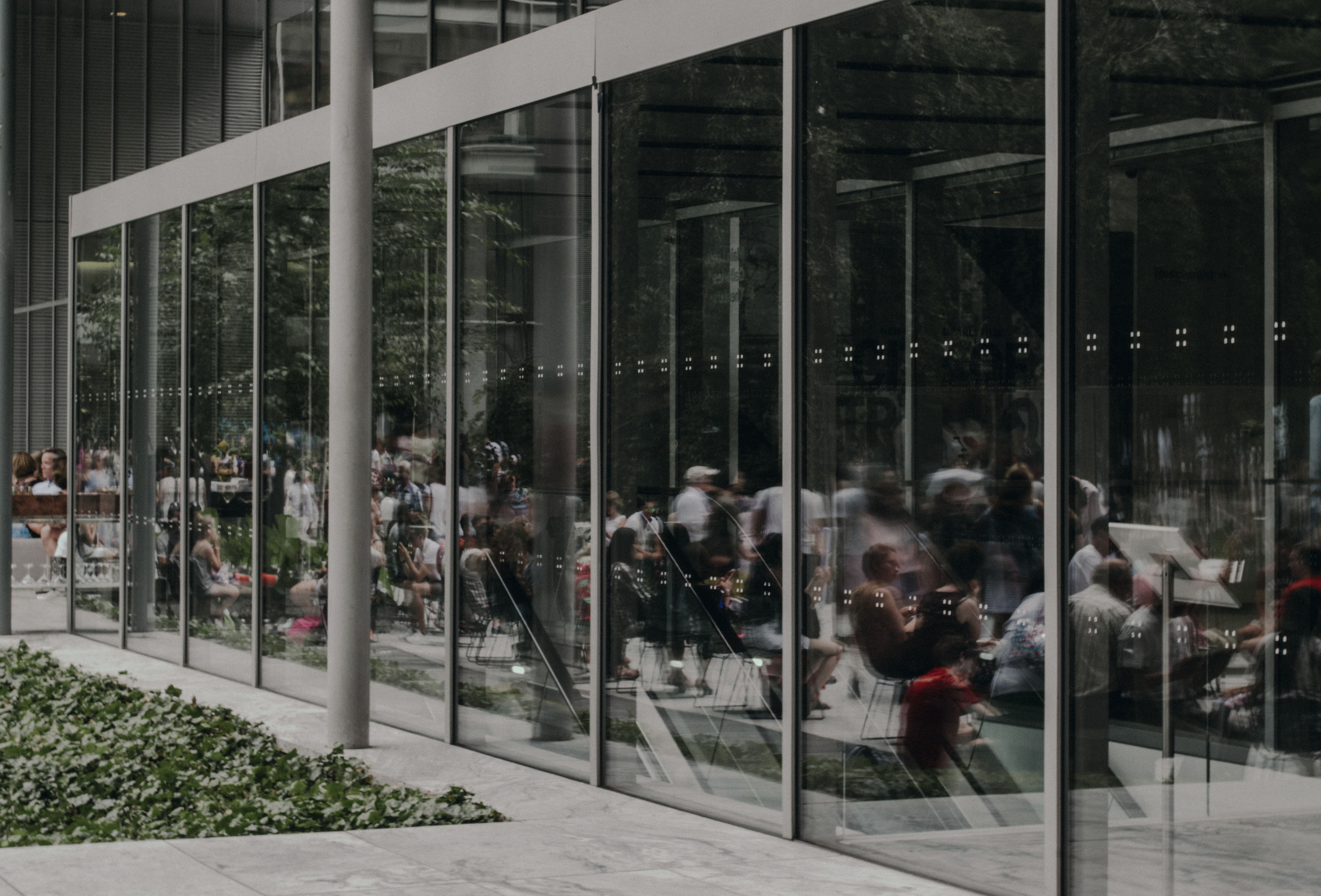 architecture, built structure, group of people, real people, glass - material, crowd, building exterior, city, men, large group of people, transparent, women, day, blurred motion, outdoors, reflection, motion, window, building, modern, office building exterior