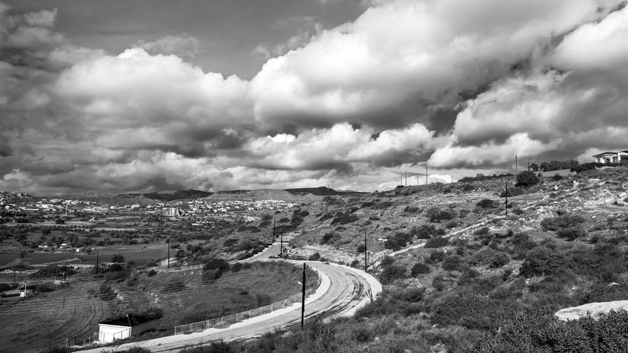 Cloud - Sky Sky Environment Scenics - Nature Beauty In Nature Day Landscape Nature No People Tranquil Scene Road High Angle View Non-urban Scene Tranquility Transportation Outdoors Mountain Architecture Ominous Blackandwhite Black And White EyeEm EyeEm Best Shots Clouds And Sky