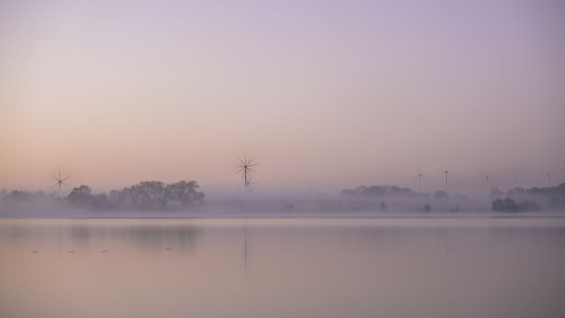 A windless dawn at the lake. Misty Wind Turbine Alternative Energy Beauty In Nature Copy Space Dawn Environment Fog Hazy  Idyllic Lake Morning Nature No People Non-urban Scene Outdoors Plant Scenics - Nature Sky Tranquil Scene Tranquility Tree Water Waterfront Windless