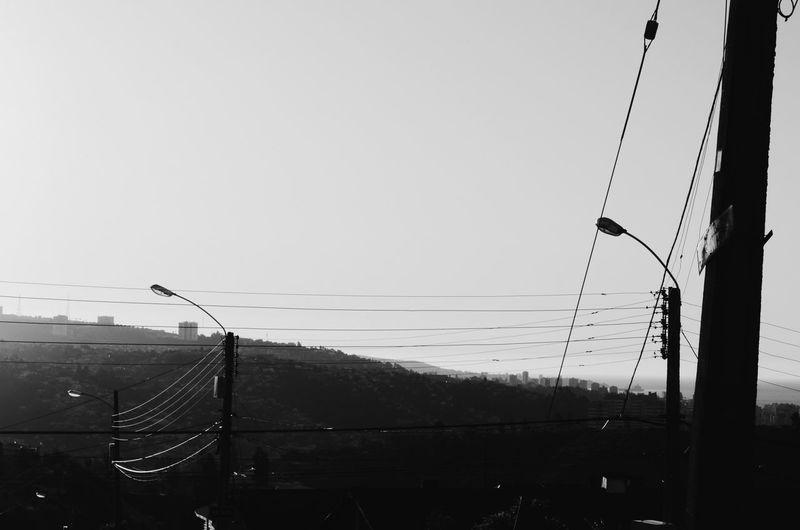Overhead cable car against clear sky