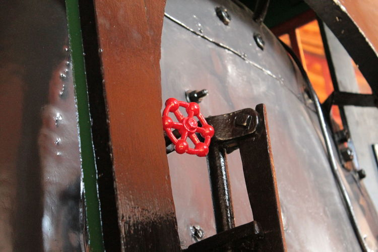Low angle view of valve on machinery