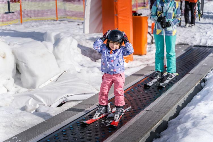 Full length of girl standing in snow