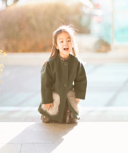 Portrait of cheerful asian girl