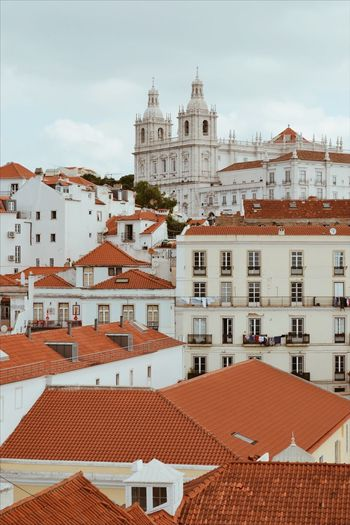 Capital of EyeEmNewHere Capital Cities  Portugal Lisbon Church Architecture Building Exterior Built Structure Building City Place Of Worship Sky Religion Roof Tile Cloud - Sky Roof Belief Residential District Travel Destinations Spirituality No People Town Tourism Nature Outdoors