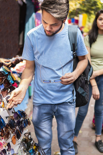 Man looking sunglasses in market