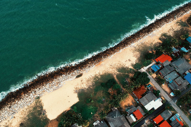 Aerial View Architecture Beach Beauty In Nature Building Exterior Built Structure Day Green Color High Angle View Land Motion Nature No People Outdoors Plant Sea Sport Swimming Pool Travel Turquoise Colored Water