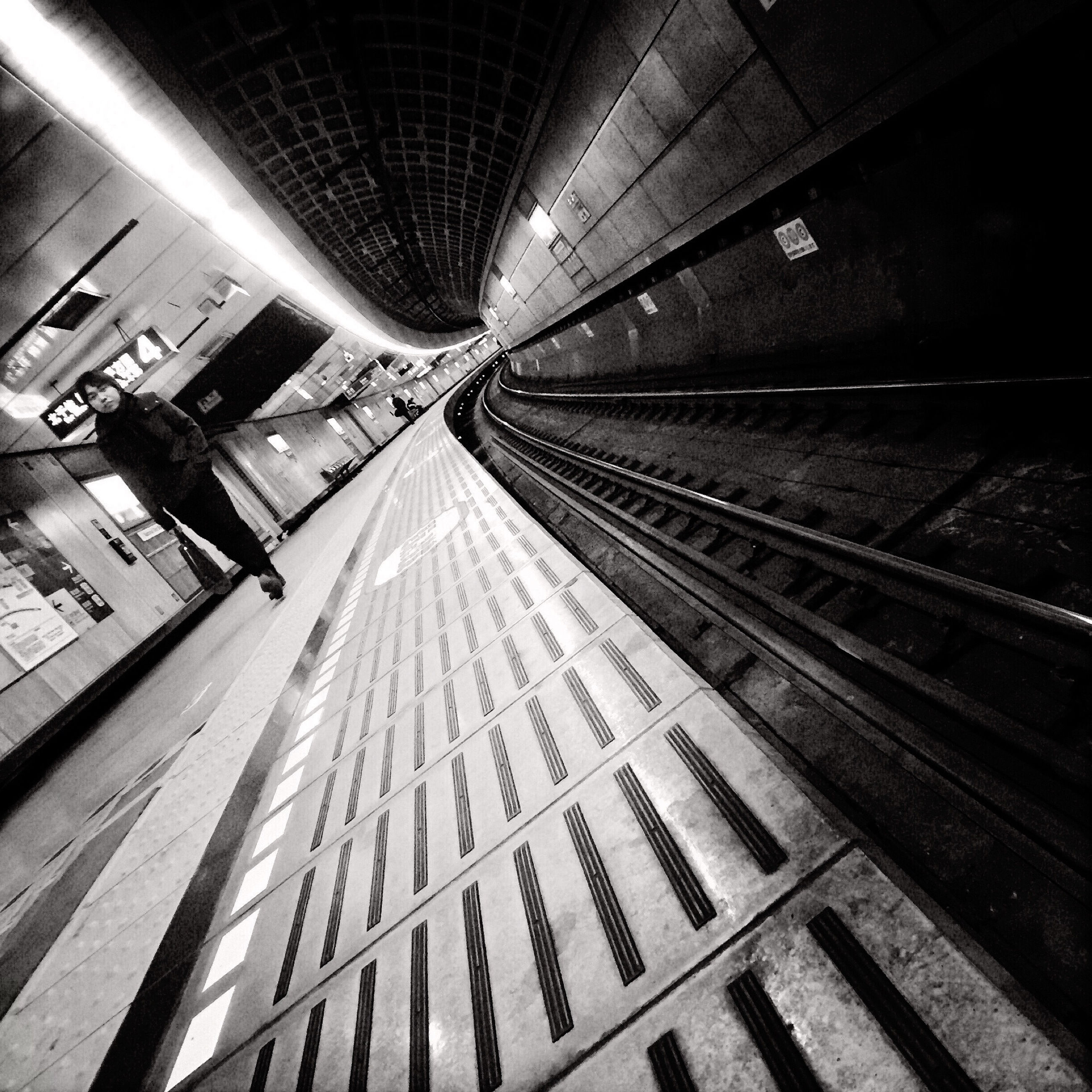 illuminated, ceiling, indoors, night, transportation, the way forward, railroad station, subway station, architecture, built structure, lighting equipment, railroad station platform, subway, diminishing perspective, incidental people, travel, public transportation, rail transportation, vanishing point, tunnel