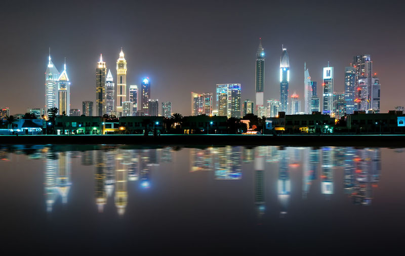 Amazing night dubai downtown skyline with tallest skyscrapers and beautiful Jumeirah beach reflection, Dubai, United Arab Emirates Dubai United Arab Emirates Architecture Building Building Exterior Built Structure City Cityscape Financial District  Illuminated Landscape Modern Night No People Office Building Exterior Outdoors Reflection Sky Skyscraper Tall - High Tower Urban Skyline Water Waterfront