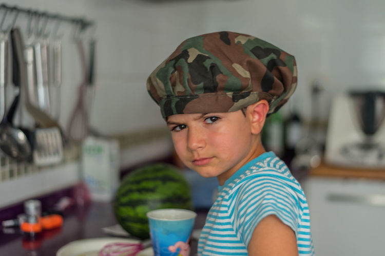 Portrait of boy wearing cap at home