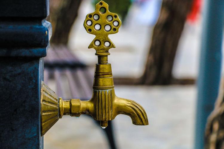 Close-up of metal faucet