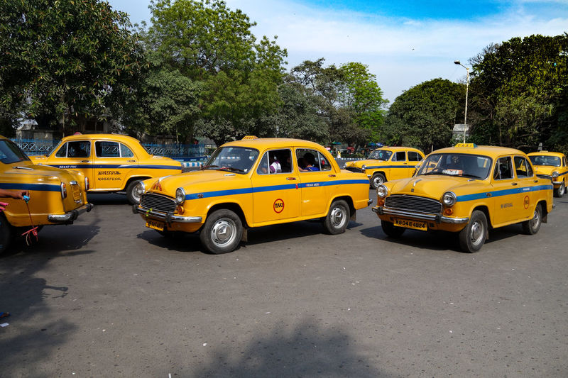 Cloud Cloud - Sky Day Green Color Growth India Kolkata Köln Land Vehicle Mode Of Transport Nature No People Outdoors Parked Parking Road Sky Stationary Sunny Taxi Transportation Tree Yellow Yellow Cabs First Eyeem Photo