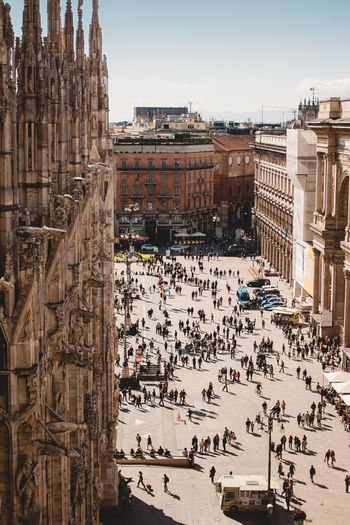 Building Exterior Large Group Of People Architecture Built Structure Travel Destinations Outdoors City Real People Lifestyles Day Crowd People People And Places Squareinstapic Square Italianstyle Roof Low Angle View Milan,Italy Milano Milan Italy Holidays Italy Photos Italy City