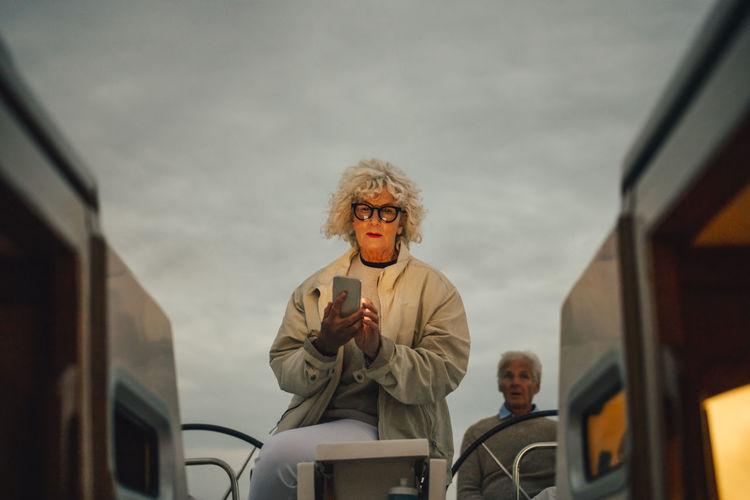 Portrait of man standing in car