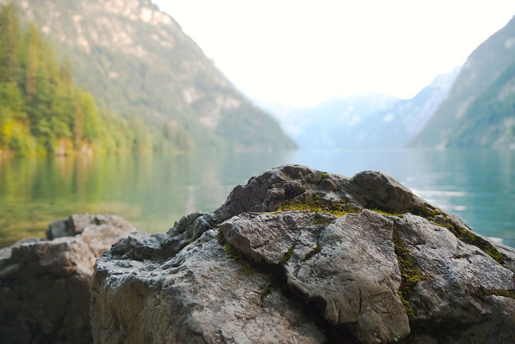Scenic view of rocks in lake against mountains