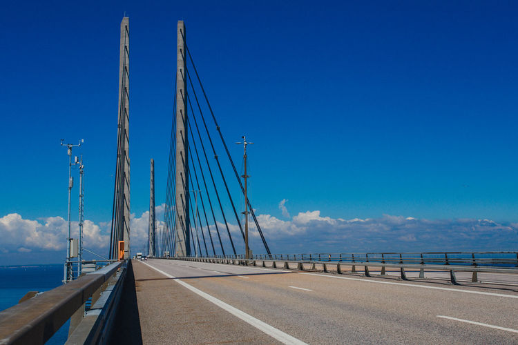 View of bridge over sea against blue sky