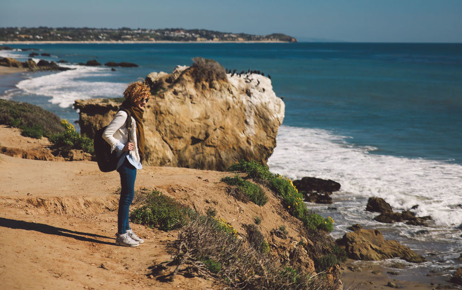 California El Matador Beach Pacific Beach Beauty In Nature Clear Sky Curly Hair Day Full Length Girl Horizon Over Water Leisure Activity Lifestyles Nature Ocean One Person Outdoors People Real People Rock - Object Rock Formation Scenics Sea Shore Sky Standing Tranquility Water Wave Women Young Adult Young Women An Eye For Travel California Dreamin