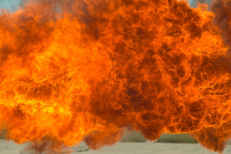 Burning Close-up Communication Exploding Fire Fire - Natural Phenomenon Fireball Flame Heat - Temperature Igniting Inferno Motion Nature No People Orange Color Outdoors Red Sign Smoke - Physical Structure Warning Sign