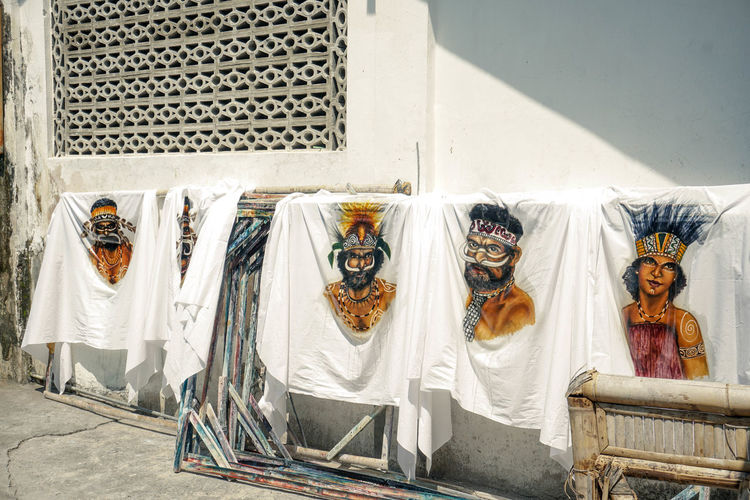 Clothes drying against white wall