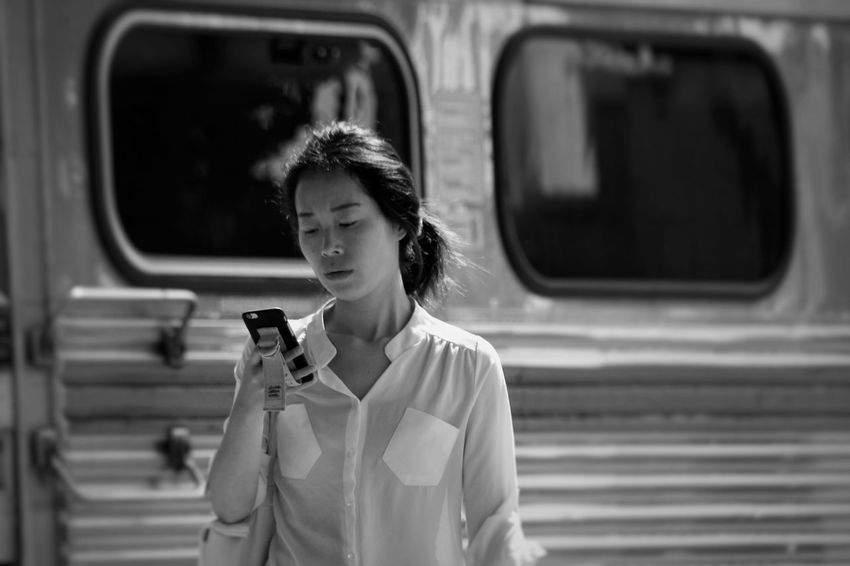 Childhood Communication Day Focus On Foreground Holding Leisure Activity Lifestyles One Person Outdoors People Real People Technology Waist Up Wireless Technology Young Adult The Fashion Photographer - 2018 EyeEm Awards