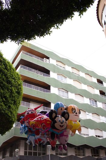 Balloons Tree Building Exterior Day Low Angle View Architecture Built Structure Outdoors Childhood Sky Trees Balloons Almoradi