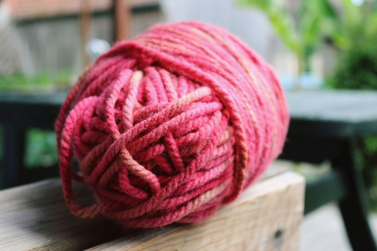 Close-Up Of Pink Thread Ball On Table