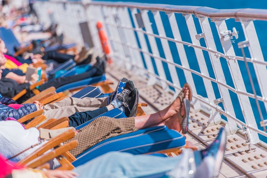 Sunny Day on the Deckchairs During Sea Travel. Cruise Ship Deck Full of People on Deckchairs. Cruise Ship Deckchairs Beach Cruise Day Nautical Nautical Vessel Outdoors People Real People Sea Sea Travel Summer Vacation Water