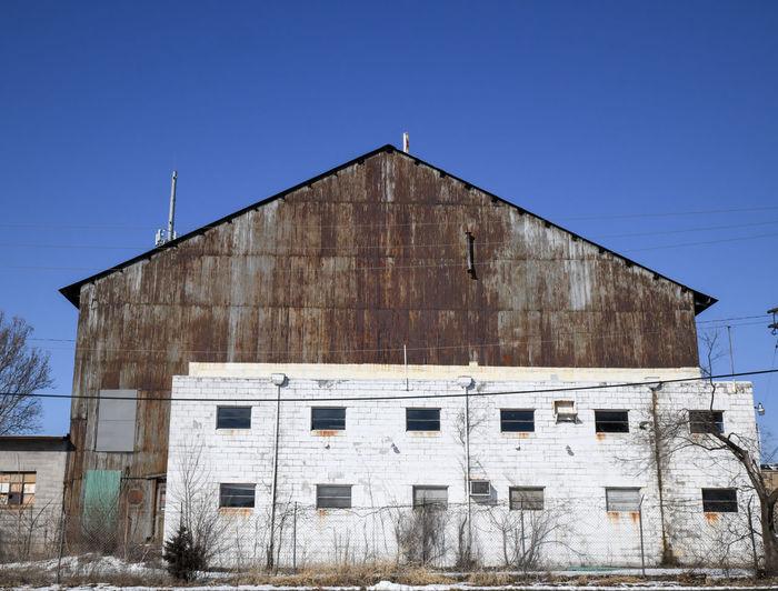Rusty metal warehouse wall