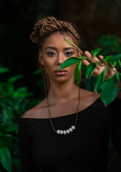 Mirembe x Peace My Best Photo One Person Portrait Looking At Camera Front View Young Adult Focus On Foreground Jewelry Beauty Necklace Leaf Lifestyles Young Women Beautiful Woman Plant Part Leisure Activity Lipstick Waist Up Make-up Green Color Plant Hairstyle Fashion Springtime Decadence