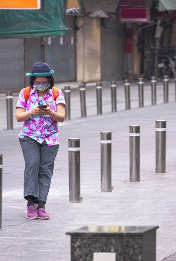 Full length of woman standing on street