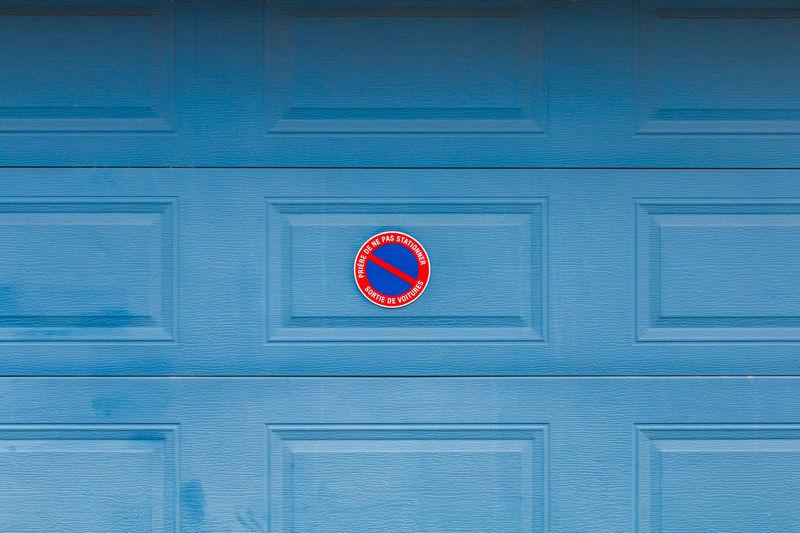 Information sign on blue door