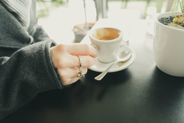 Female human hand holding a cup of hot espresso coffee. Espresso Morning Adult Coffe Break  Coffee Coffee - Drink Coffee Cup Crockery Cup Drink Finger Food And Drink Hand Holding Hot Drink Human Body Part Human Hand Lifestyles Mug One Person Real People Refreshment Saucer Tea Cup Women