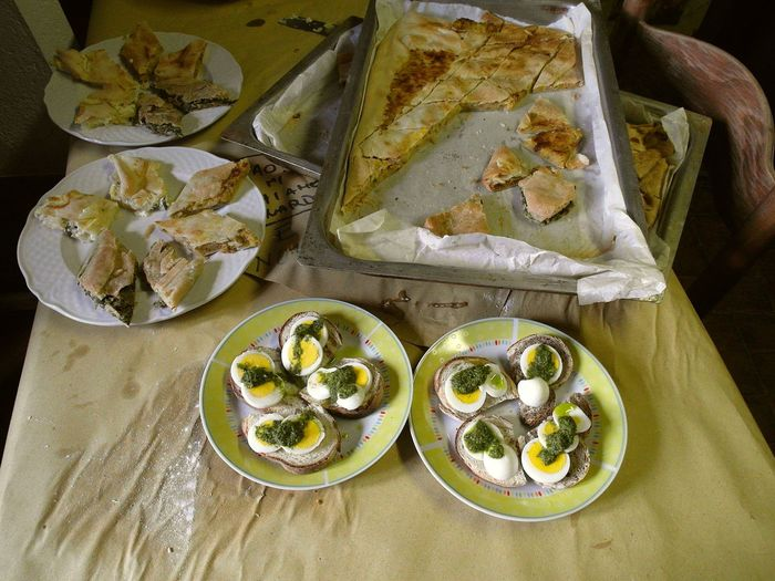 Two dishes with hard-boiled eggs and rustic pizza Close-up Food Food And Drink Freshness Hard-boiled Eggs Healthy Eating High Angle View Indoors  Kitchen Plate Ready-to-eat Rustic Pizza SLICE Table