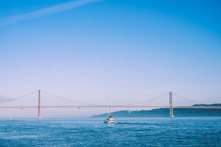 Clear day overlooking the bridge in Lisbon Architecture Built Structure Travel Destinations Lisbon Portugal Europe Water Suspension Bridge Bridge Bridge - Man Made Structure Connection Transportation Sky Copy Space Sea Tourism Travel Engineering Nature Bay Clear Sky Bay Of Water Outdoors