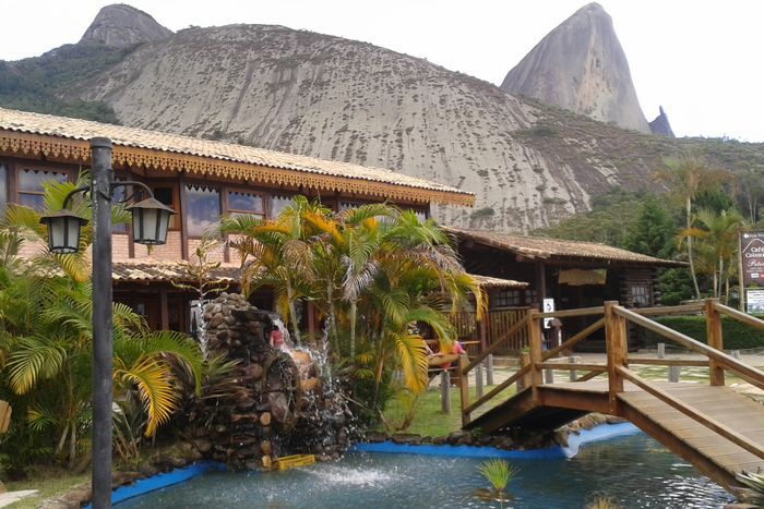 Wheel Building Exterior Built Structure Day Mountain Outdoors Sky Thatched Roof Water
