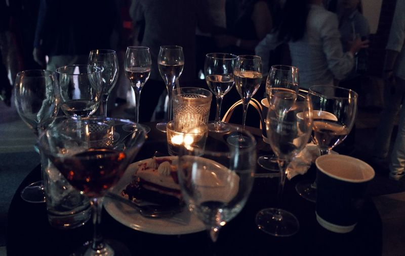 Close-up of wine glasses on table at restaurant
