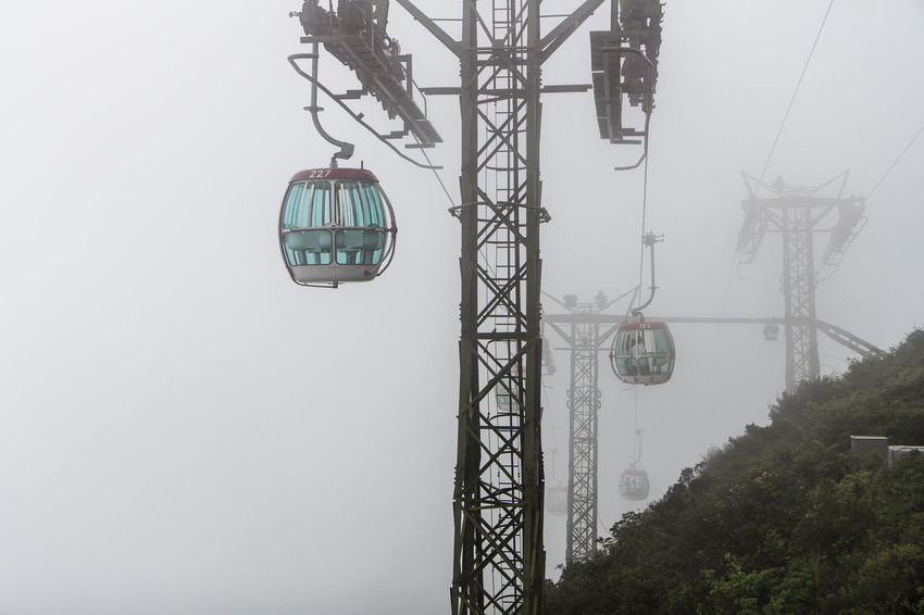 Cable Day Electricity Pylon Fog Hanging Hong Kong Misty Nature No People Outdoors Overhead Cable Car Ski Lift Sky Technology Transportation Tree