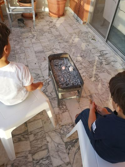 BBQ Marshmallows Technology Men Working Occupation Business Finance And Industry Wireless Technology High Angle View