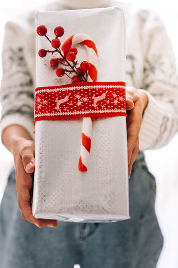 Midsection of woman holding christmas decoration in box