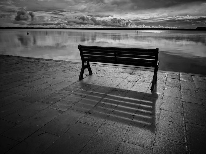 part of this Blackandwhite Tranquility Mindfulness Lagoon Mobilephotography Reflection Bw Bw_lover Water Beach Sea Relaxation Sand Sky Bench Lakeside Calm