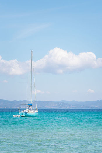 Vacations Tourism Leisure Activity Serenity Tranquil Scene Nautical Vessel Sea Water Sailboat Transportation Sky Cloud - Sky Mode Of Transportation Sailing Beauty In Nature Scenics - Nature Day Nature Waterfront Tranquility Pole Blue Horizon Over Water No People Outdoors Turquoise Colored Yacht Luxury Yachting Moored