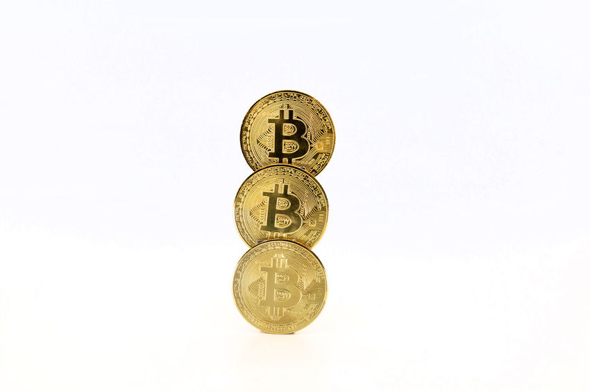 Bitcoin tokens stacked isolated on white background. Cryptocurrency concept with copy space. BTC Banknotes Copy Space E-commerce Gold Isolated Virtual Bit  Bitcoin Bussiness Coin Concept Crypto Cryptocurrency Cypto Currency Euro Exchange Future Internet Minning Minning Bitcoin Money Pay Symbol White Background