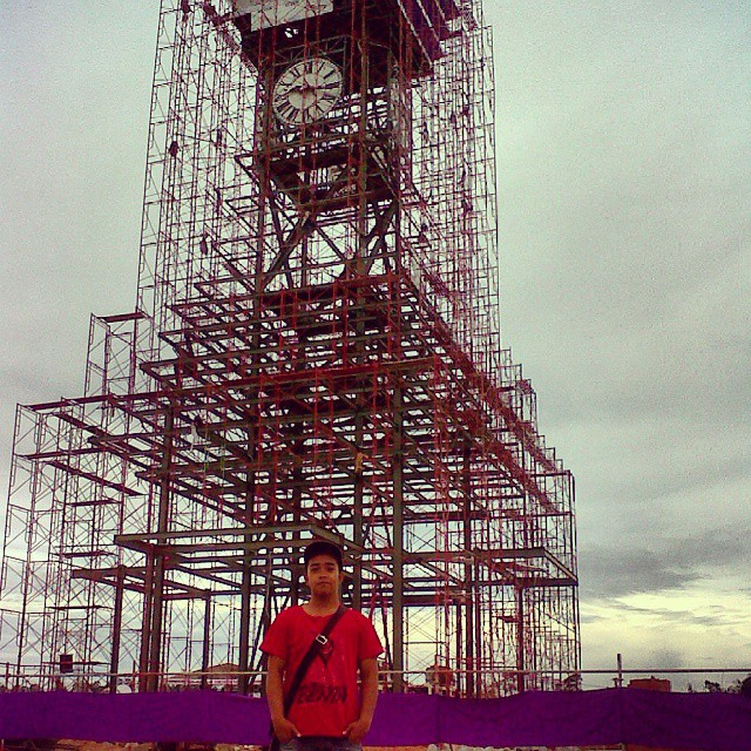 lifestyles, leisure activity, built structure, architecture, sky, rear view, standing, building exterior, men, casual clothing, low angle view, childhood, amusement park, person, ferris wheel, amusement park ride, arts culture and entertainment