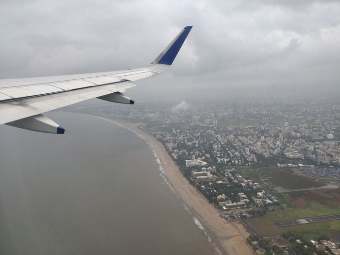 Mumbai - You are such a beauty!❤️ Mumbai MumbaiDiaries Mumbai_uncensored Airplane City Flying Cityscape Aerial View Air Vehicle Aircraft Wing Sky Landscape Plane Cumulonimbus Airshow Aerobatics Office Building Torrential Rain Skyscraper Urban Skyline Tall - High Residential Structure Tower Boat Settlement Thunderstorm Vapor Trail Financial District  Air Force Formation Flying The Great Outdoors - 2018 EyeEm Awards