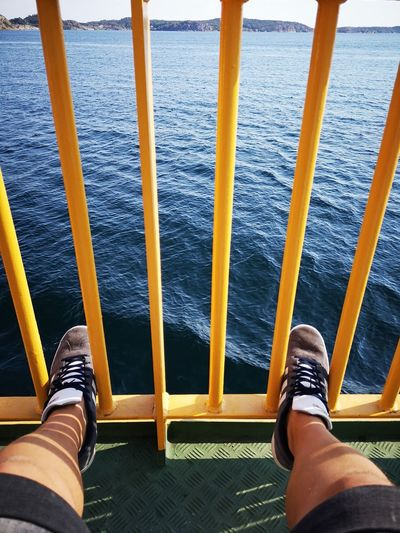 Ferryride Ferry Ocean Yellow Bars No Edit/no Filter Huaweiphotography Leicacamera Channel Summertime Real People Low Section Men Human Leg Standing Shoe Personal Perspective High Angle View Close-up Footwear Things That Go Together Pair Human Foot Hand Rail